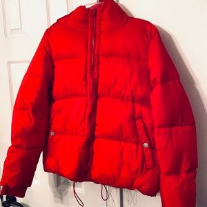 Woman's red puffer jacket